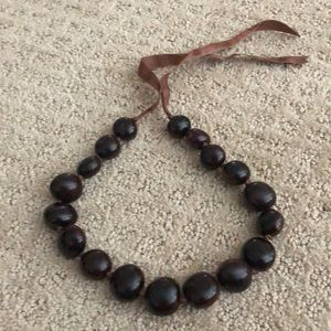 Brown jumbo bead necklace with tie bow back